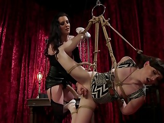 Dominatrix anal fucks shemale in bondage