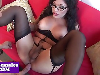 Busty tgirl cockriding while in stockings